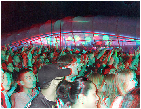 Concert goers and the Long White Cloud. Digital 3-D Photography by Marc Dawson.
